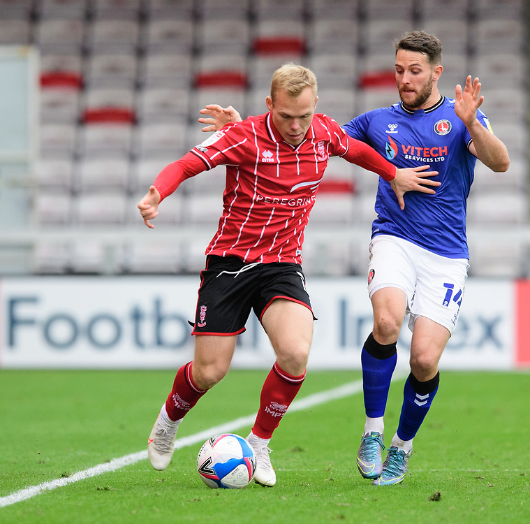 Lincoln City's Anthony Scully vies for possession with Charlton Athletic's Conor Washington<br /> <br /> Photographer Chris Vaughan/CameraSport<br /> <br /> The EFL Sky Bet League One - Lincoln City v Charlton Athletic - Sunday 27th September, 2020 - LNER Stadium - Lincoln<br /> <br /> World Copyright © 2020 CameraSport. All rights reserved. 43 Linden Ave. Countesthorpe. Leicester. England. LE8 5PG - Tel: +44 (0) 116 277 4147 - admin@camerasport.com - www.camerasport.com