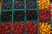Different varieties of berries for sale at the Pasadena Farmers' Market in Los Angeles, California.
