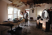 Mr.and Mrs Kergosian of Bay St. Louis Mississippi clean up after Hurricane Katrina filled thier home with 8ft of muddy water and a tree fell on their roof Sept 18,2005. The Kergosians who have been married for 50 years, and live in the home Mr. Kergosian grew up in, rode the storm out in their home.They are standing in what is left of their living room.Photo ©SUZI ALTMAN PHOTOGRAPHER www.suzisnaps.com .cell phone 601-668-9611.NO PRINTS NO WEB NO DISTRIBUTION. (Photo/Suzi Altman)