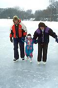 Family age 39 through 5 ice skating at Bracket Park. Minneapolis Minnesota USA