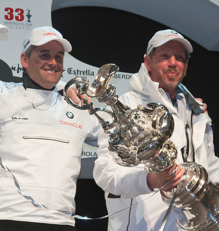 Receiving the Cup: Russell Coutts and Larry EllisonHanding over the America's Cup<br /> BMW Oracle wins the America's Cup<br /> 2010 America's Cup, Valencia<br /> ©2010 Kaufmann/Forster go4image.com