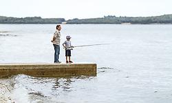 THEMENBILD - ein Opa mit seinem Enkel beim fischen an der Adria, aufgenommen am 28. Juni 2018 in Fazana, Kroatien // a grandfather fishing with his grandson on the Adriatic Sea, Fazana, Croatia on 2018/06/28. EXPA Pictures © 2018, PhotoCredit: EXPA/ JFK