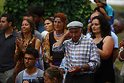 Villagers and visitors during a festivity exhibition for thanking for the hospitality at the small village of Salto, Montalegre. European Rainbow Gathering of 2011 in Portugal