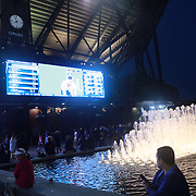 2017 U.S. Open - August 28. DAY ONE. A night scene outside Arthur Ashe Satdium as spectators watch the action on the outside screen at the US Open Tennis Tournament at the USTA Billie Jean King National Tennis Center on August 28, 2017 in Flushing, Queens, New York City.  (Photo by Tim Clayton/Corbis via Getty Images)