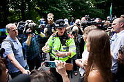 The commanding officer explains police tactics to MP Caroline Lucas and local activist Vanessa Vine from Frack Free Sussex. Thousands  turned out for a march of solidarity against fracking in Balcombe. The village Balcombe in Sussex is the  centre of fracking by the company Cuadrilla. The march saw anti-fracking movements from the Lancashire and the North, Wales and other communities around the UK under threat of gas and oil exploration by fracking.