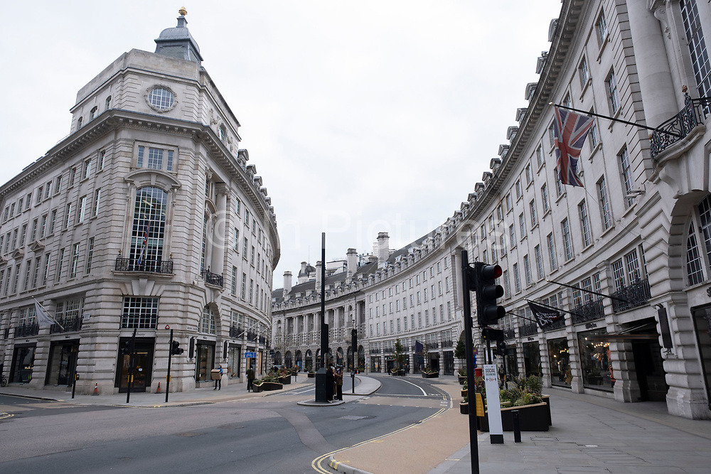 Scene of empty deserted Regent Street as the national coronavirus lockdown three continues on 5th March 2021 in London, United Kingdom. With the roadmap for coming out of the lockdown has been laid out, this nationwide lockdown continues to advise all citizens to follow the message to stay at home, protect the NHS and save lives, and the streets of the capital are quiet and empty of normal numbers of people.