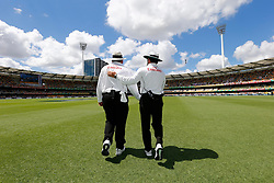 Umpires Aleem Dar and Marais Erasmus walk out for the start of play during day two of the Ashes Test match at The Gabba, Brisbane.