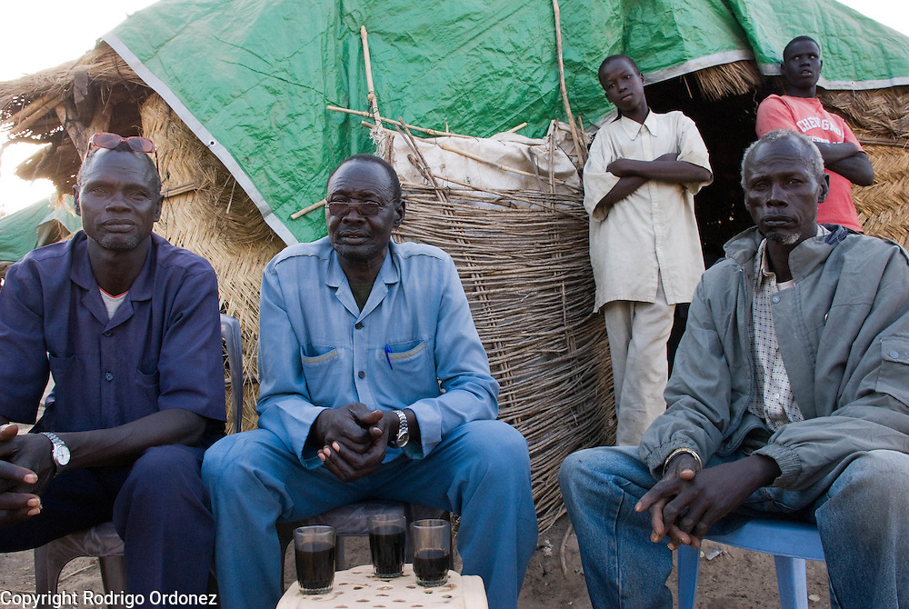 A group of men sits outside a tea shop in the town of Abyei.