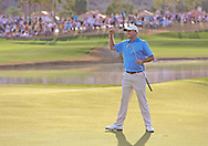 """22 JAN 15  Champion Bill Haas on the 18th green at the conclusion of Sunday""""s Final Round at The Humana Challenge at PGA West, in LaQuinta, California.(photo credit : kenneth e. dennis/kendennisphoto.com)"""