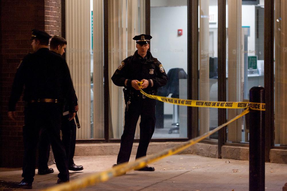 Boston, MA 11/21/2010.Boston Police officers string crime scene tape across Centre St. after a shooting inside the Same Old Place restaurant in Jamaica Plain on Sunday evening..Alex Jones / www.alexjonesphoto.com