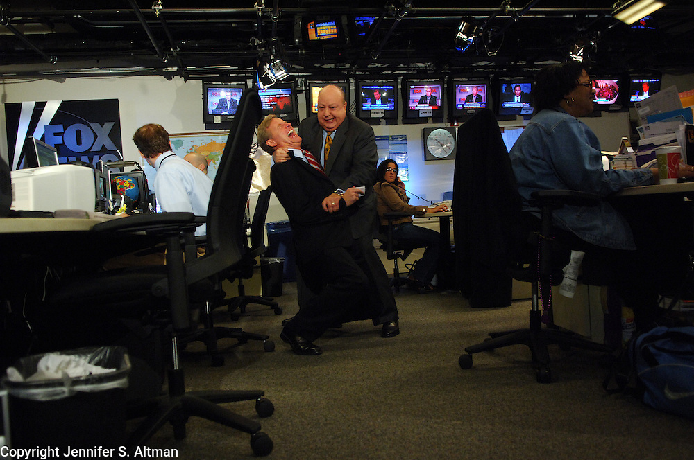 Roger Ailes, Fox News CEO and Chairman and Chairman of Fox Television Stations, is seen playing around with Steve Doocy, host of Fox and Friends, with blond hair, in the newsroom in Manhattan, NY. 9/29/2006 Photo by Jennifer S. Altman/For The Times
