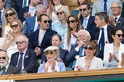 © Licensed to London News Pictures. 12/07/2019. London, UK. Phillipa Law, Jude Law, Anna Grant and Hugh watch centre court tennis in the royal box on Day 11 of the Wimbledon Tennis Championships 2019 held at the All England Lawn Tennis and Croquet Club. Photo credit: Ray Tang/LNP