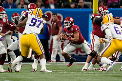 Jalen Hurts #1 of the Oklahoma Sooners runs the ball during the first half against the LSU Tigers in the 2019 College Football Playoff Semifinal at the Chick-fil-A Peach Bowl on Saturday, Dec. 28, in Atlanta. (Paul Abell via Abell Images for the Chick-fil-A Peach Bowl)