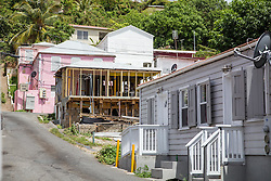 The EDA works with owners to help the correctly and adequately take care of the historic buildings.  The Virgin Islands Economic Development Association Enterprise & Commercial Zone Commission hosts a historical tour through the Savan (Savanne) neighborhood.   St. Thomas, US Virgin Islands.  9 July 2015.  © Aisha-Zakiya Boyd