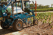 A vineyard tractor equipped with claws to work the soil and remove weed, also equipped for spraying - Chateau Belgrave, Haut-Medoc, Grand Crus Classee 1855