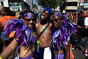 Parade dancers at Notting Hill Carnival on 26th August 2019 in West London, United Kingdom. A celebration of West Indian / Caribbean culture and Europes largest street party, festival and parade. Revellers come in their hundreds of thousands to have fun, dance, drink and let go in the brilliant atmosphere. It is led by members of the West Indian / Caribbean community, particularly the Trinidadian and Tobagonian British population, many of whom have lived in the area since the 1950s. The carnival has attracted up to 2 million people in the past and centres around a parade of floats, dancers and sound systems.