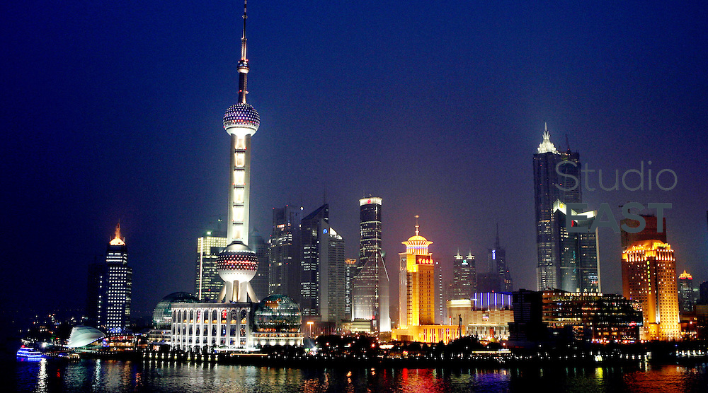 SHANGHAI, CHINA - April 18: The Shanghai Pudong Skyline, including the Oriental Pearl TV Tower (left), is seen from the Bund side on April 18, 2009 in Shanghai, China. (Photo by Lucas Schifres/Getty Images)