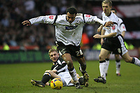 Photo: Pete Lorence.<br />Derby County v Hull City. Coca Cola Championship. 10/02/2007.<br />Giles Barnes darts over a tackle by Andy Dawson.