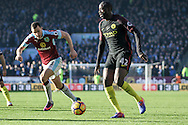 Manchester City midfielder Yaya Toure chased down by Burnley defender Daniel Lafferty during the Premier League match between Burnley and Manchester City at Turf Moor, Burnley, England on 26 November 2016. Photo by Pete Burns.