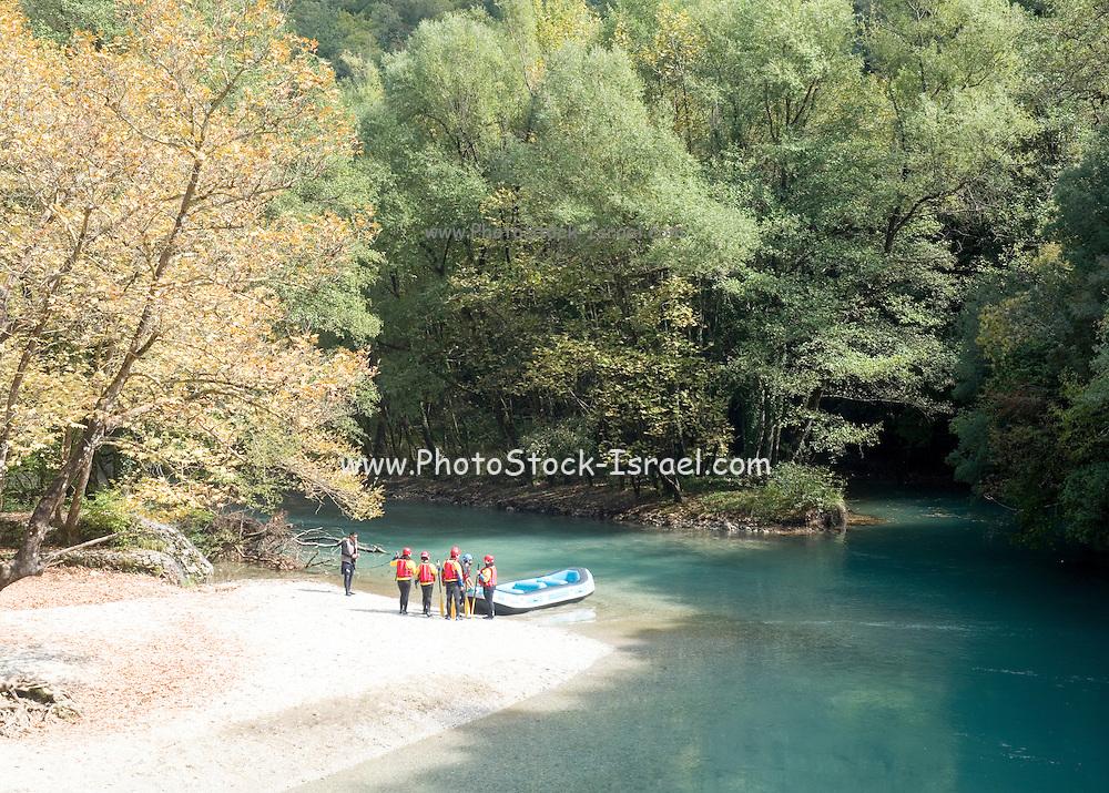 Rafting in Voidomatis river, close to Kleidonia stone bridge, Zagori, Pindus mountains, Epirus, Greece.