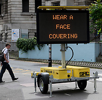 wear a face covering reminder  near waterloo station photo by Brian Jordan
