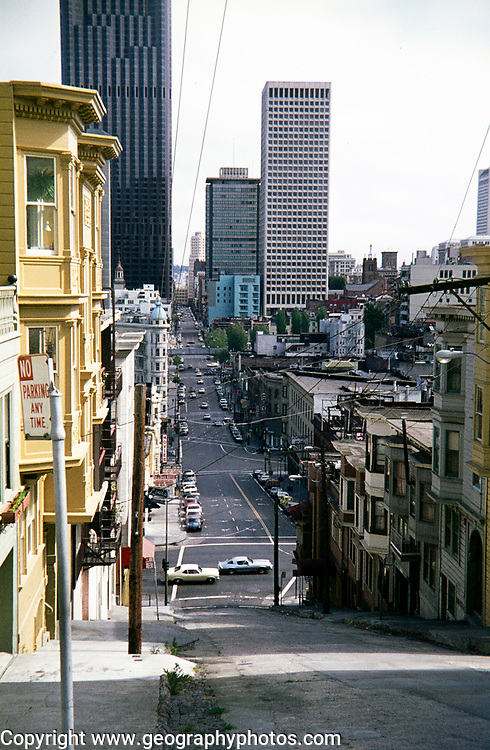 Cityscape view from steep hill of downtown CBD buildings, San Francisco, California, USA 1976