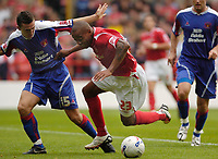 Photo: Leigh Quinnell.<br /> Nottingham Forest v Carlisle United. Coca Cola League 1. 16/09/2006. Forests Junior Agogo is tumbled over in the box by Carlisles Paul Arnison, but the penalty is not given.