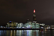 The top spire of the Shard is illuminated in red, on December 4th 2017 in London, United Kingdom, on the first evening of the Shards festive Christmas light show. Every evening, counting down to the start of 2018, the Shard will illuminate the London skyline from dusk till dawn, with Western Europe's highest light show each evening during December.