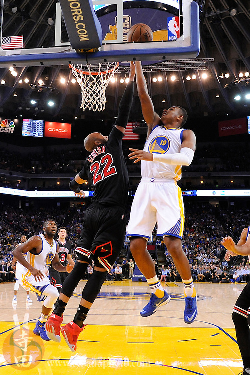 November 20, 2015; Oakland, CA, USA; Golden State Warriors guard Leandro Barbosa (19) shoots a layup against Chicago Bulls forward Taj Gibson (22) during the fourth quarter at Oracle Arena. The Warriors defeated the Bulls 106-94.