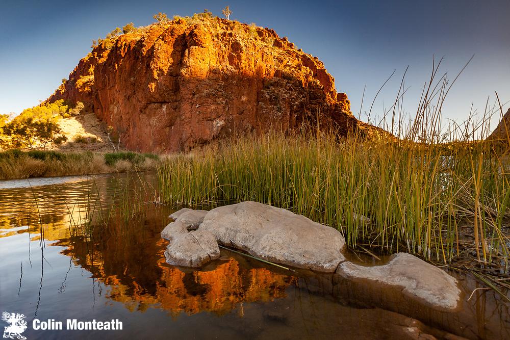 Sunset reflection on billabong, Finke River, Glen Helen Gorge, MacDonnell Ranges, Northern Territory, Central Australia