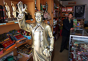 SHAOSHAN, CHINA - 4 NOVEMBER 2005 - The propritor of a Mao shop waits for customers in Shaoshan. Rows of Mao souvenir stalls offer tourists a dizzying array of memorabilia - garish clocks, numerous statues, badges and pens.