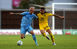 Coventry City's Jack Grimmer (left) and Oxford United's Marcus Browne (right) battle for the ball