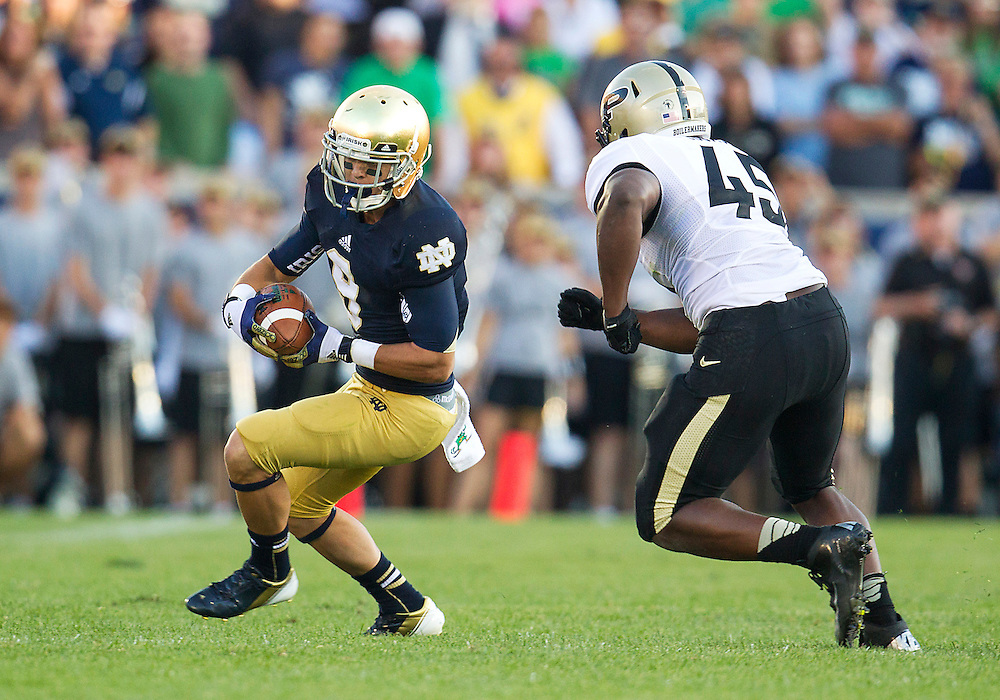 September 08, 2012:  Notre Dame wide receiver Robby Toma (9) runs for yardage as Purdue linebacker Will Lucas (45) pursues during NCAA Football game action between the Notre Dame Fighting Irish and the Purdue Boilermakers at Notre Dame Stadium in South Bend, Indiana.  Notre Dame defeated Purdue 20-17.