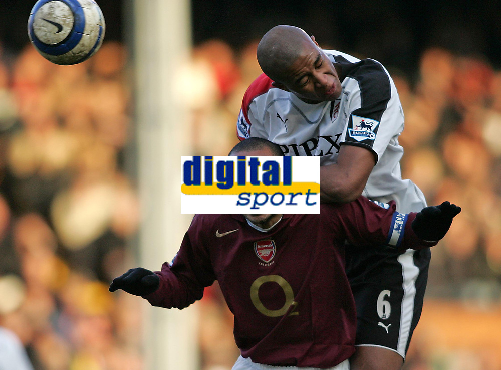 Photo: Lee Earle.<br /> Fulham v Arsenal. The Barclays Premiership. 04/03/2006. Arsenal's Thierry Henry (L) clashes with Zat Knight.
