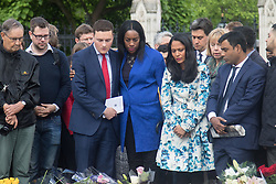 Parliament Square, Westminster, London, June 17th 2016. Following the murder of Jo Cox MP a vigil is held as friends and members of the public lay flowers, light candles and leave notes of condolence and love in Parliament Square, opposite the House of Commons. PICTURED: Labour MP Wes Streeting in the red tie surveys the floral tributes.