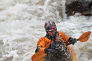 061210-Morrison, COLORADO-wildwaterart-Kayaker Jake Vos, of Denver, maneuvers through the white water rapids Saturday, June 12, 2010 on Bear Creek. Heavy rain fall at higher elevations has caused the normally peaceful creek to swell. .Photo By Matthew Jonas/Evergreen Newspapers/Photo Editor