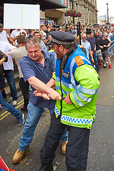 © Licensed to London News Pictures. 09/06/2018. LONDON, UK.  Protesters throw objects and scuffle with police after a rally calling for the release of Tommy Robinson (aka Stephen Yaxley-Lennon) who was recently jailed for 13 months for contempt of court.   Photo credit: Cliff Hide/LNP
