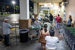 September 6, 2017 - Florida, U.S. - Customers line up outside the Publix on Southern Boulevard in Palm Beach before the 6:30 a.m. opening Wednesday, hoping to beat the crowds stocking up on supplies. (Credit Image: © Lannis Waters/The Palm Beach Post via ZUMA Wire)