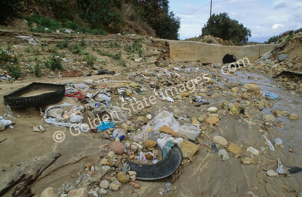Litter and trash along Tijuana River.