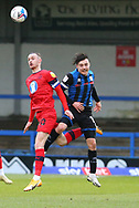 Wigan Athletic forward Will Keane(10) and Ollie Rathbone of Rochdale (14)  challenge for a header during the EFL Sky Bet League 1 match between Rochdale and Wigan Athletic at the Crown Oil Arena, Rochdale, England on 16 January 2021.
