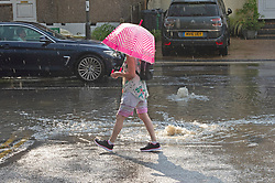 © Licensed to London News Pictures 20/07/2021. Orpington, UK. Overflowing drains in the road in Orpington. Heatwave thunderstorms hit Orpington in South East London causing roads to flood and drains to overflow. Photo credit:LNP