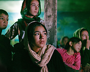 Young girl and boys watching TV.  The traditional life of the Wakhi people, in the Wakhan corridor, amongst the Pamir mountains.