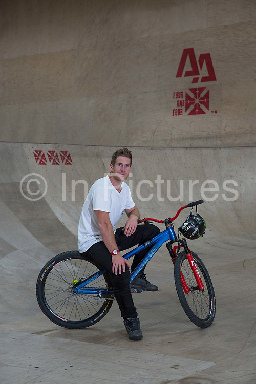 Professional freeride mountain biker Sam Pilgrim at Adrenaline Alley on the 17th September 2018 in Corby in the United Kingdom. Adrenaline Alley is a huge indoor sports centre with professional riding areas for BMX bikes, skateboards and scooters.