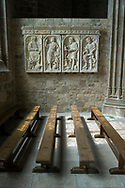 """A bas-relief sculpture of """"The Four Evangelist"""", dated to 1547, is seen on a wall in the abbey of Mont Saint-Michel. Located in Normandy, France, the abbey was constructed between the 11th and 16th centuries; in 1979 the area was made a UNESCO World Heritage Site."""