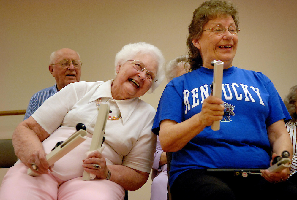 """From the back room of the Stephens Lake Activity Center, the soft bell tones of """"Somewhere Over the Rainbow"""" are punctuated with bursts of laughter. Nadine Sargent has hit the wrong note. Again. She laughs at the rare mistake on the shoulder of fellow hand bell player Barb Jackson, who, in turn, gets the giggles.<br /> <br /> At the end of the tune, the group's leader, Cookie Hagen, couldn't be more satisfied. Even with Nadine's missed notes, a missing pianist and only half of her normal group of 30, Cookie is elated. """"You sounded really, really good."""" She emphasizes the point with a bright smile.<br /> <br /> """"Even though we make mistakes, she tries to make us feel good,"""" Nadine says.<br /> <br /> The group has been active for five years through the Columbia Parks and Recreation Department and the Older American Klub.<br /> <br /> """"Our mission is to share music with the Columbia community,"""" Cookie says. """"We welcome anyone who wants to join us.""""<br /> <br /> That inclusive atmosphere is on display between practice sessions. The incoming adaptive bell choir greets the outgoing seniors. The group comes together to celebrate August birthdays, chatting on folding chairs in the hallway. Ice cream sandwiches disappear into smiling faces.<br /> <br /> Another successful practice."""