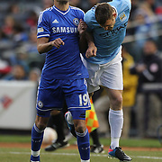 Paulo Ferreira, Chelsea, is challenged by James Milner, Manchester City, during the Manchester City V Chelsea friendly exhibition match at Yankee Stadium, The Bronx, New York. Manchester City won the match 5-3. New York. USA. 25th May 2012. Photo Tim Clayton