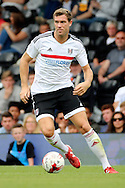 Fulham midfielder, Kevin McDonald dribbling during the Pre-Season Friendly match between Fulham and Crystal Palace at Craven Cottage, London, England on 30 July 2016. Photo by Matthew Redman.