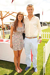 HARRY WENTWORTH-STANLEY and his sister LOUISA WENTWORTH-STANLEY at the Cartier International Polo at Guards Polo Club, Windsor Great Park, Berkshire on 25th July 2010.