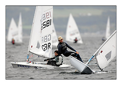 The second day of racing at the World Laser Radial Youth Championships, Largs, Scotland..Tadeusz Kubiak POL 192583 and Andrew Mcgowan GBR 196581..317 Youth Sailors from 42 different nations compete in the World and European Laser Radial Youth Champiponship from the 17-25 July 2010...The Laser Radial World Championships take place every year. This is the first time they have been held in Scotland and are part of the initiaitve to bring key world class events to Britain in the lead up to the 2012 Olympic Games. ..The Laser is the world's most popular singlehanded sailing dinghy and is sailed and raced worldwide. ..Further media information from .laserworlds@gmail.com.event press officer mobile +44 7866 571932 and +44 1475 675129 .