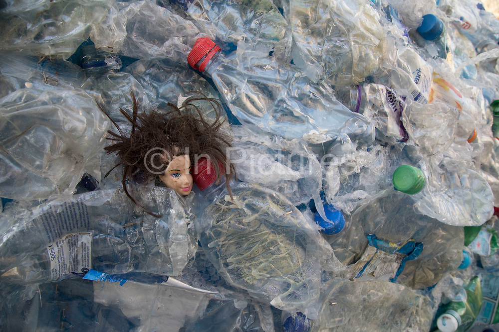 Close up of a dolls head encouraging people to take action against single use plastic and to promote knowledge about the environmental disaster affecting the World's oceans and seas on 6th February 2018 in London, England, United Kingdom. Sky Ocean Rescue campaign outside Parliament Sky Ocean Rescue aims to highlight issues affecting ocean health, find innovative solutions to the problem of ocean plastics, and inspire people to make small everyday changes that collectively make a huge difference.